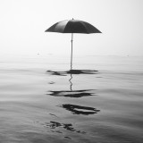 Umbrella floating on water