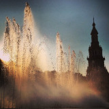 This is Plaza de España, in Seville (Spain). Iberoamerican Expo was held here in 1929. There is a fountain in the middle of the square and you can see one of the towers. This place appears in many films like