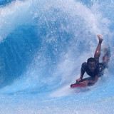 One surfer catching a great wave on the wave machine at the Wavehouse in San Diego California.