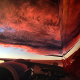 This is the reflection of the sky on a Southwest Airlines Boeing 737-800 during a calm before a storm.