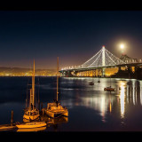 #new #baybridge #treasureisland #sf #SanFrancisco #bay #oakland #reflections #California #ca #night #longexposure #boats #bright #moon