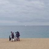 These kids were out early on a Saturday morning picking up trash off the beach.