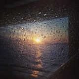 Through the glass. Sunset on the boat last night coming back into NYC.