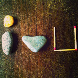 Stones, rocks and match sticks arranged to spell out the phrase I love you.