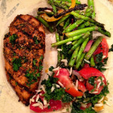 Grilled Jamaican jerk chicken, tomato kale orzo mix, and grilled asparagus salad