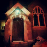 Mass Appeal...side doorway of an historic New England at night.#church #historic #historical #door #doorway #archway #stone #brick #old #newengland #windows #ornate  #religious #architecture .Through the #car #window while #driving at #night in #newengland.#igersnewengland #igersboston #iheartboston