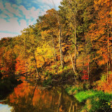 This is classic October in northeast Ohio. The colored leaves reflecting in the water were a bonus!