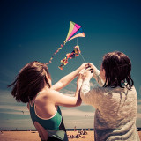 My daughter and her friend flying a kite at Brighton Beach in the south eastern suburb of Melbourne, Australia.