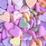 Pastel colored sugar hearts, close-up