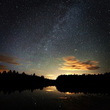 Starry night sky over lake