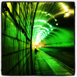 Illuminated tunnel in city