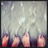 Barefooted couple in running water