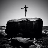 Woman levitating above a rock