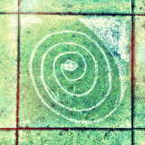 Spiral design made by chalk on footpath