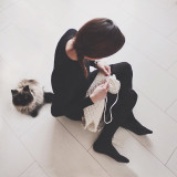 Woman knitting with cat