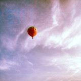 Hot air balloon against clouds