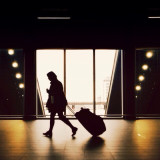Woman pulling suitcase