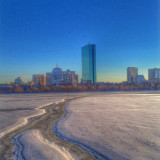 winter view of Boston from Cambridge across the frozen river