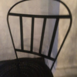 Blur of chair back against white marble pillar
