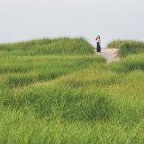 Young woman by grassy bank