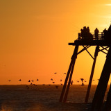 Early birds get the worm - and a spectacular sunrise at the Kure Beach fishing pier.