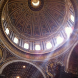 The interior of the dome at St. Peter's Basilica at the Vatican.  Rome, Italy