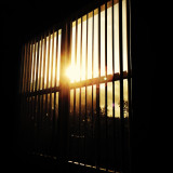 View of sunset through security bars