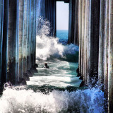 Incoming tide under pier