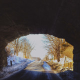 Country road beneath bridge in winter