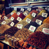 Various tea leaves and spices for sale in market