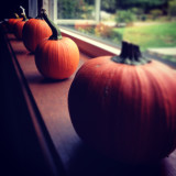 Pumpkins next to window sill