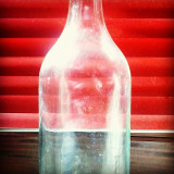 Empty homemade tomato juice bottle.