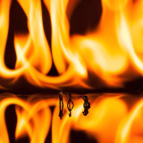 Macro shot with fire and miniature figurines