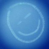 Smiley face on blue glass