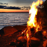 Beautiful sunset and bonfire with the lake nice and calm. Amazing summer evening in the Kawarthas Canada.