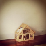The tiny doll house puts our lives into perspective in this huge world.