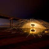 Illuminated steel wool spinning