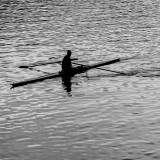 Rowing Single  on  river before sunset