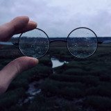 Landscape seen through pair of round glasses