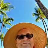 Beautiful Adventure for a Baby Boomer in a Straw Hat on a Tropical Beach with Tropical Vibes and Blue Sky and Palm Trees!