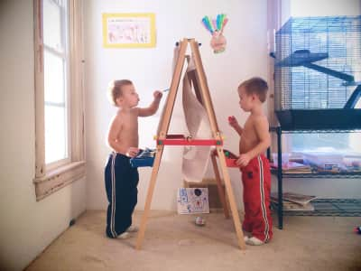 Boys creating with paint