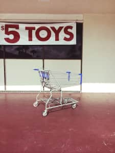 Shopping cart in empty parking