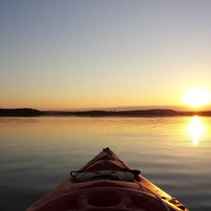 Kayaking on a beautiful afternoon sunset.