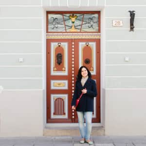 Olga near beautiful door in Tallinn, Estonia