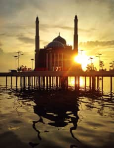Mosque above the water with sunset or sunrise