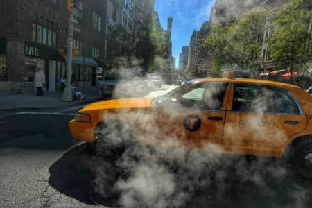 Smoking yellow cab at the streets of New York