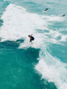 A man catches a wave