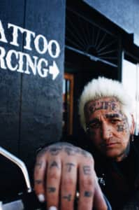 Lenny Mental, tattooed local tucson punk rock figure. Well known for his unruly antics and self destructive stage presence.