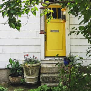 On a walk and found this quaint yellow door. A must snap!
