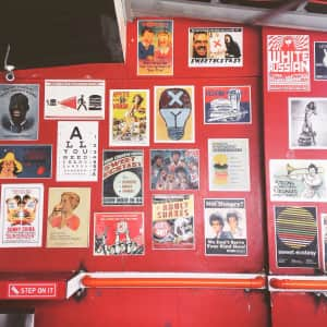 Vintage posters on a red wall